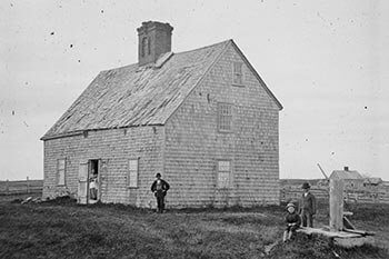 Oldest House, ca. 1860, with members of the Turner family posing for the camera.