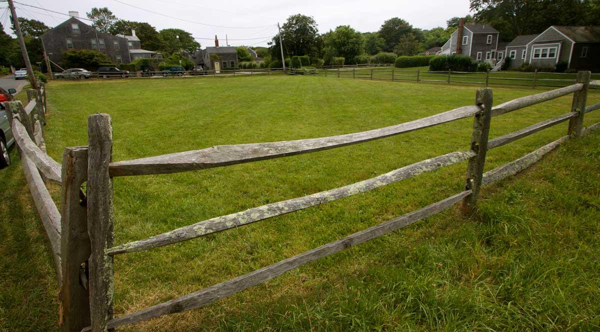 Field with split rail fence.